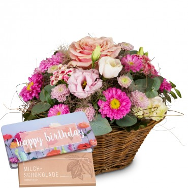 "Basket Filled with Delicate Flowers with bar of chocolate ""Happy Birthday"""