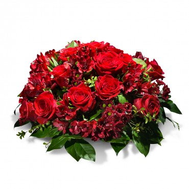 Condolence centrepiece in red shades
